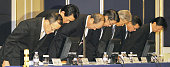 TOKYO Japan Olympus Corp President Shuichi Takayama and other executives of the camera and medical equipment maker bow at a press conference in Tokyo...
