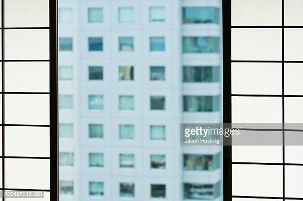 Japan, Osaka, Japanese paper screen and office building