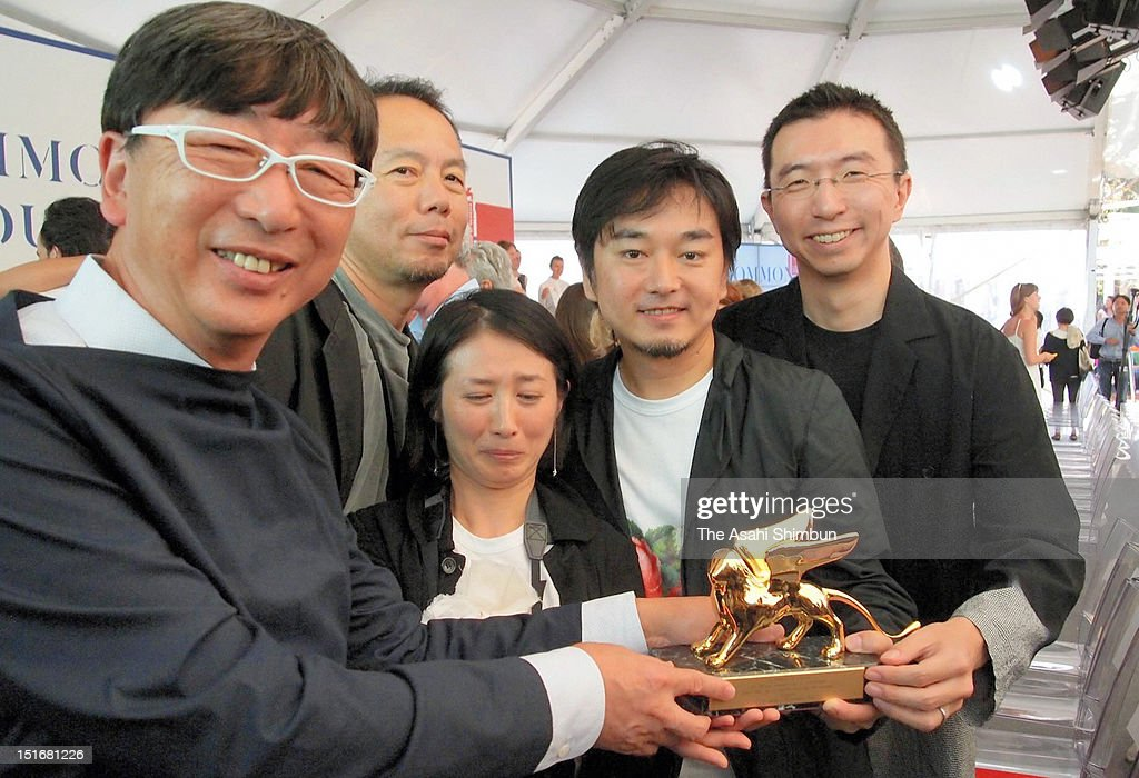 Japan Pavilion presented by Toyo Ito (1L) and his team members Naoya Hatakeyama (2L), Kumiko Inui (C), Akihisa Hirata (2R), Sosuke Fujimoto (1R) pose for photographs with the trophy after winning the Golden Lion for the Best National Participation at the 13th Venice Biennale International Architecture Exhibition, titled gArchitecture, possible here? Home-for-Allh and dedicated to the victims of the Great East Japan Earthquake