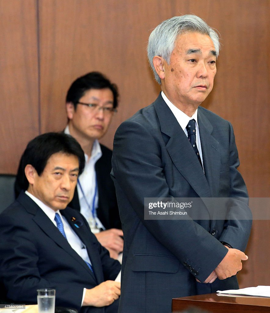 Japan Pension Service President Toichiro Mizushima bows for apology for the leak of more than 1 million cases of pension-related data at a Lower House committee while Health Minister <a gi-track='captionPersonalityLinkClicked' href=/galleries/search?phrase=Yasuhisa+Shiozaki&family=editorial&specificpeople=642749 ng-click='$event.stopPropagation()'>Yasuhisa Shiozaki</a> watches on June 3, 2015 in Tokyo, Japan. The Japan Pension Service apologised amid an onslaught of criticism over the leak of 1.25 million cases of personal information and the agency's 'unacceptable' safeguards for handling such sensitive data.