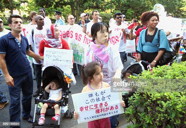 TOKYO Japan People demonstrate against a new registration system for foreigners in Tokyo's Kasumigaseki district of government ministries and...