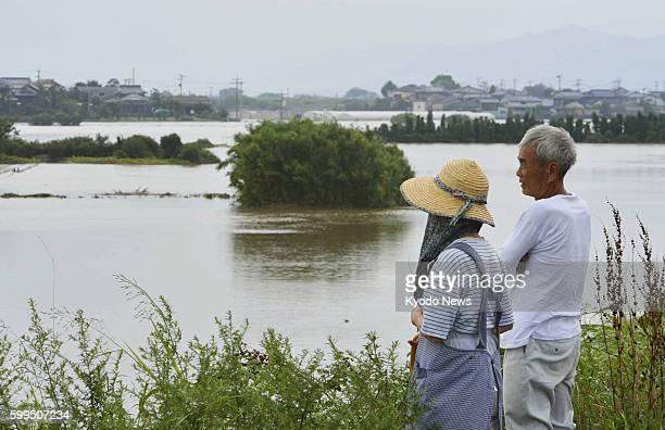 KURUME Japan People look at farmland inundated due to torrential rain in Kurume Fukuoka Prefecture on July 14 2012