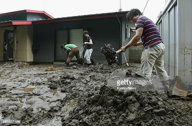 KUMAMOTO Japan People remove sediment spread by the flooding of the Shirakwa River in the city of Kumamoto on July 13 after heavy rain hit...
