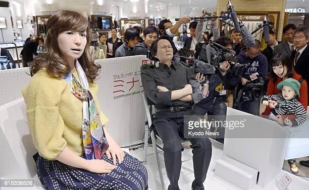 OSAKA Japan Photo shows a female humanoid robot called Minami and another robot made to resemble Osaka University professor Hiroshi Ishiguro at a...
