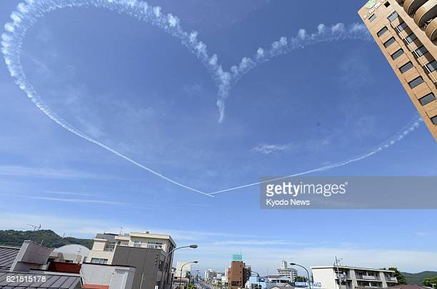 FUKUSHIMA Japan Photo shows a heart shape created by the Blue Impulse flight team from the Air SelfDefense Force in the sky above Fukushima City on...
