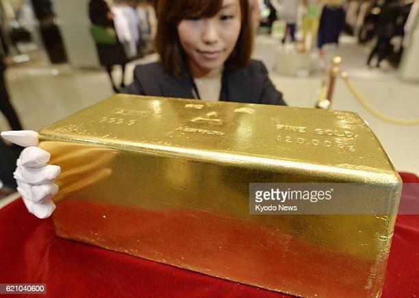 TOKYO Japan Photo shows a piece of gold bullion weighing 120 kilograms and worth 600 million yen at Takashimaya department store in Tokyo's Shinjuku...