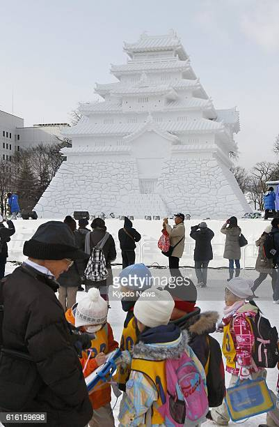 SAPPORO Japan Photo shows a snow sculpture of Tsurugajo a castle in Aizuwakamatsu Fukushima Prefecture at Odori Park in Sapporo Hokkaido on Feb 6 at...