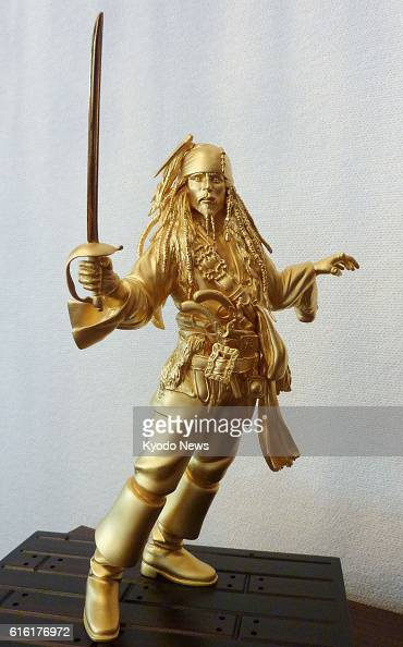 TOYAMA Japan Photo shows Japanese metal manufacturer and processor Kurotani Corp's solid gold figure of Jack Sparrow the main character of the Walt...