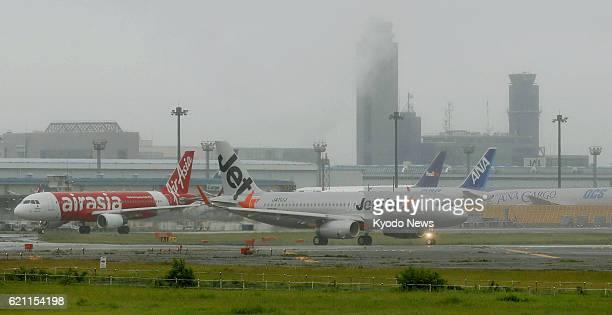 NARITA Japan Photo shows planes of budget airlines Jetstar Japan Co and AirAsia Japan Co at Narita airport near Tokyo on May 20 2013 The airport...