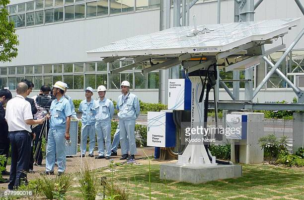 OSAKA Japan Photo shows Sumitomo Electric Industries Ltd's solar power equipment which will be used for its nextgeneration power grid system called...