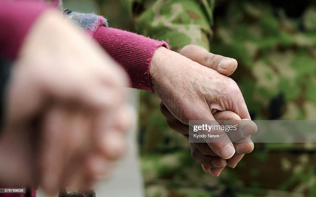 NATORI Japan Photo taken April 11 shows hands of people participating in a memorial ceremony in Natori Miyagi Prefecture for the victims of a massive...