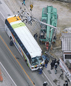 OKAYAMA Japan Photo taken from a Kyodo News helicopter shows a school bus and a truckmounted crane in Niimi Okayama Prefecture after a collision on...