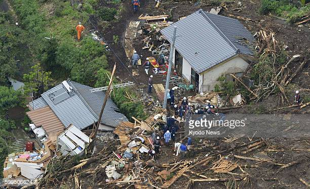 MINAMIASO Japan Photo taken from a Kyodo News helicopter shows rescue workers searching for people who have gone missing at the site of a landslide...