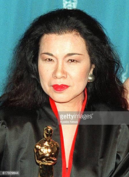 TOKYO Japan Photo taken in 1993 shows renowned designer Eiko Ishioka holding an Oscar trophy Ishioka winner of an Academy Award for costume design...