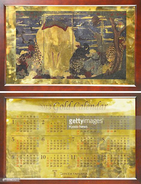 TOKYO Japan Photo taken Nov 13 in Tokyo's Ginza district shows a calendar made of pure gold featuring a key work of the 18th Century painter Ito...