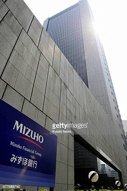 TOKYO Japan Photo taken on May 18 shows the headquarters of Mizuho Bank in Tokyo's Chiyoda Ward Mizuho Financial Group Inc plans to merge its two...