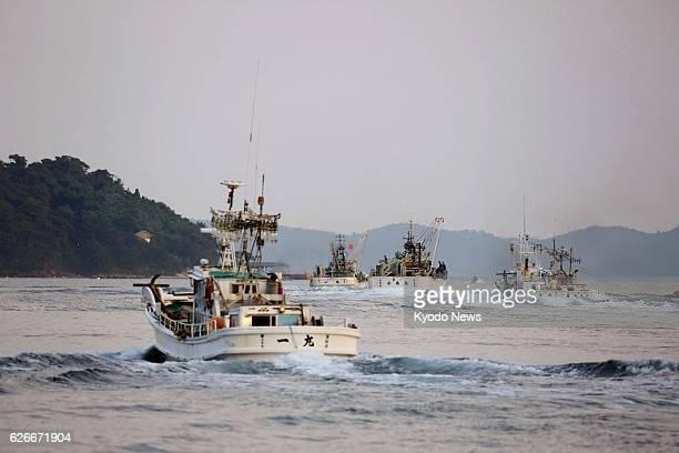 NISHINOSHIMA Japan Photo taken Sept 10 2013 shows a fleet of purse seine fishery including the Ichimaru fishing boat leaving Urago Port toward...