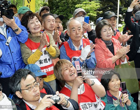 YOKOHAMA Japan Plaintiffs celebrate in front of the Yokohama District Court in Kanagawa Prefecture on May 21 after the court ordered the government...