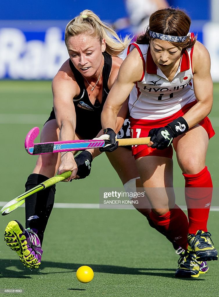 Japan player Akane Shibata (R) vies for the ball with New Zealand player Stacey Michelsen (L) during the Field Hockey World Cup Women's tournament match Japan vs New Zealand on June 7, 2014, in The Hague.