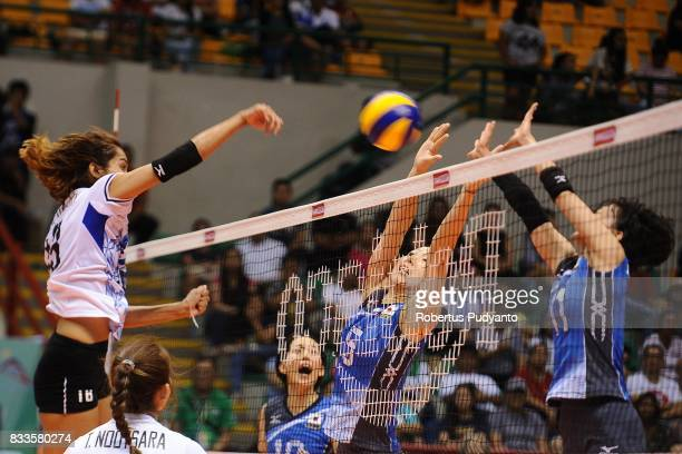 Japan players block Kongyot Ajcharaporn of Thailand spike during the 19th Asian Senior Women's Volleyball Championship 2017 Final match between...
