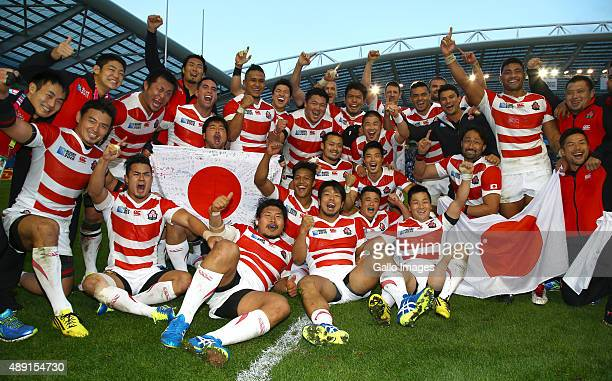 Japan players celebrate after the win over South Africa during the Rugby World Cup 2015 Pool B match between South Africa and Japan at Brighton...