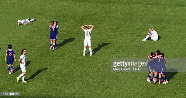 Japan players celebrate at the full time whistle as England players sink to the floor during the FIFA Women's World Cup 2015 Semi Final match between...