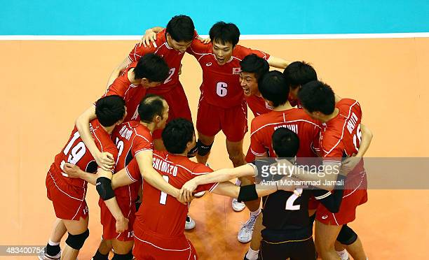 Japan Players celebrate during 18th Asian Senior Men's Volleyball Championship in final between Iran against Japan on August 8 2015 in Tehran Iran