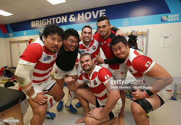 Japan players celebrate in the dressing room following victory in the 2015 Rugby World Cup Pool B match between South Africa and Japan at Brighton...