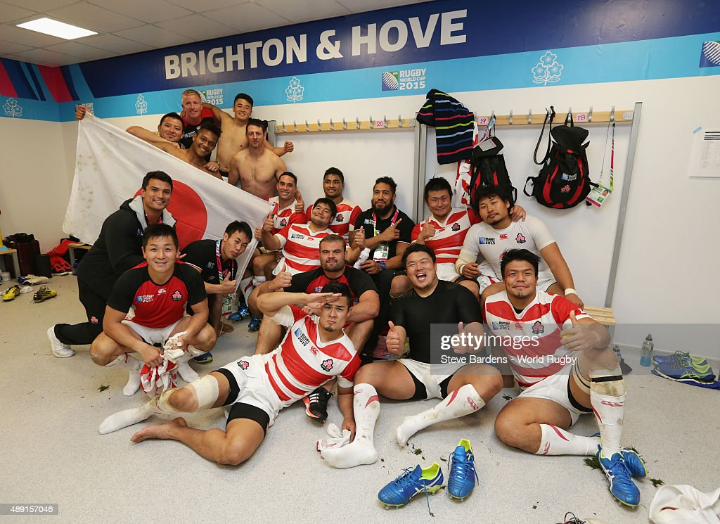 Japan players celebrate in the dressing room following victory in the 2015 Rugby World Cup Pool B match between South Africa and Japan at Brighton Community Stadium on September 19, 2015 in Brighton, United Kingdom.