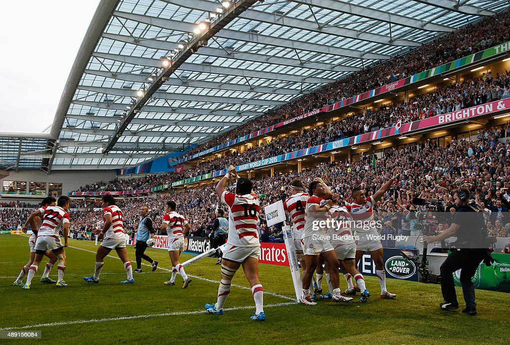 Japan players celebrate the winning try of Karne Hesketh of Japan during the 2015 Rugby World Cup Pool B match between South Africa and Japan at Brighton Community Stadium on September 19, 2015 in Brighton, United Kingdom.