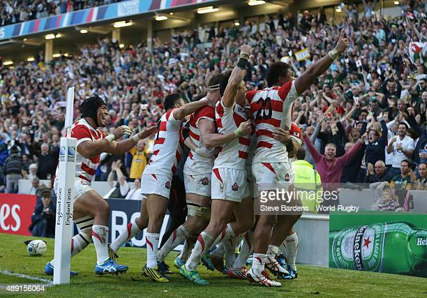 Japan players celebrate the winning try scored by Karne Hesketh of Japan during the 2015 Rugby World Cup Pool B match between South Africa and Japan...