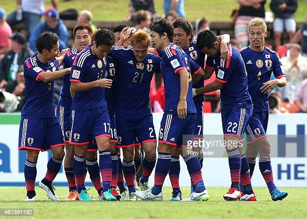 Japan players celebrate their first goal by Yasuhito Endo during the 2015 Asian Cup match between Japan and Palestine at Hunter Stadium on January 12...