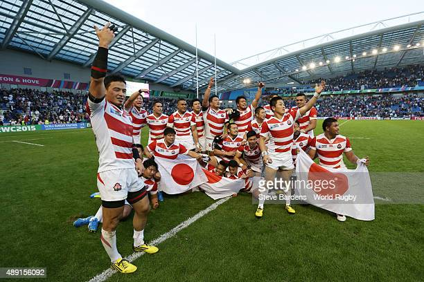 Japan players celebrate their surprise win during the 2015 Rugby World Cup Pool B match between South Africa and Japan at Brighton Community Stadium...
