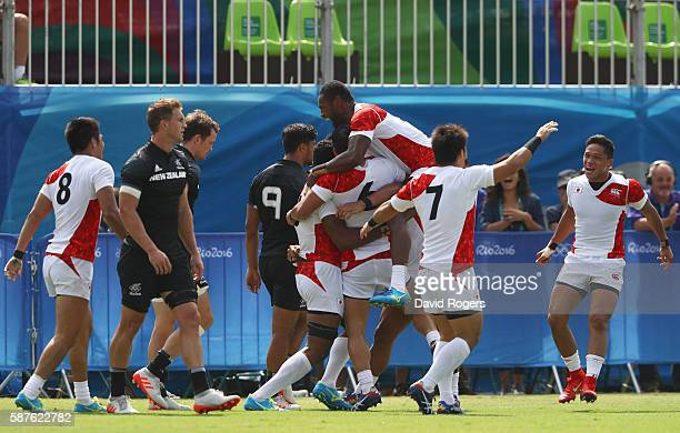Japan players celebrate victory after the Men's Rugby Sevens Pool C match between New Zealand and Japan on Day 4 of the Rio 2016 Olympic Games at...
