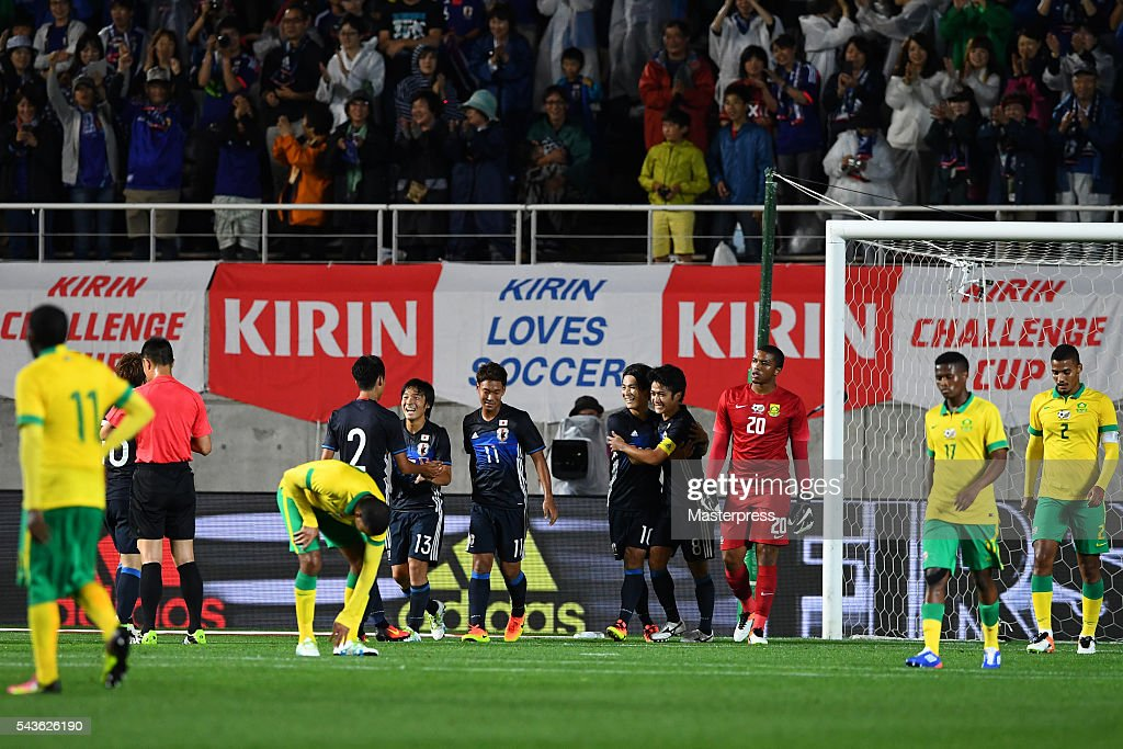 Japan players celebrates after scoring the first goal during the U-23 international friendly match between Japan v South Africa at the Matsumotodaira Football Stadium on June 29, 2016 in Matsumoto, Nagano, Japan.