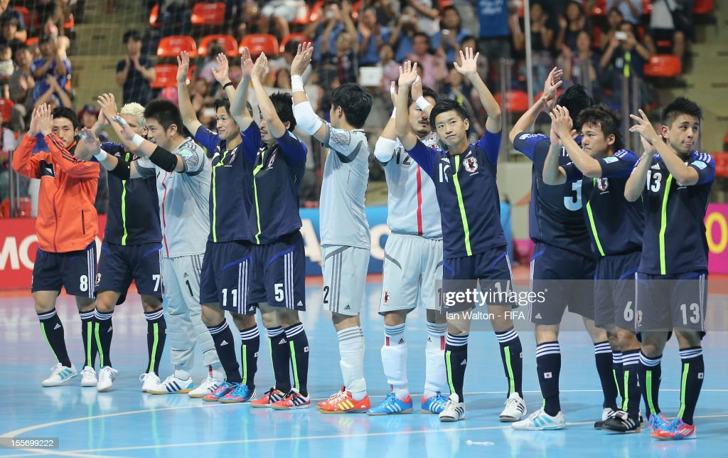 Japan players celebrates after winning the FIFA Futsal World Cup Group C match between Japan and Libya at Indoor Stadium Huamark on November 7, 2012 in Bangkok, Thailand.