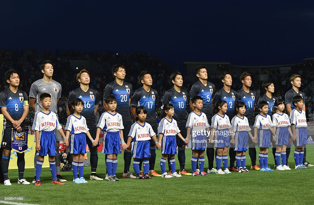 Japan players line up for the national anthem prior to the U-23 international friendly match between Japan and South Africa at the Matsumotodaira Football Stadium on June 29, 2016 in Matsumoto, Nagano, Japan.