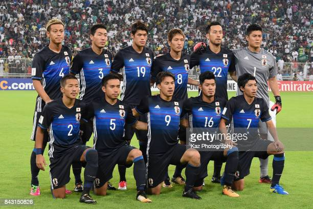Japan players line up for the team photos prior to the FIFA World Cup qualifier match between Saudi Arabia and Japan at the King Abdullah Sports City...