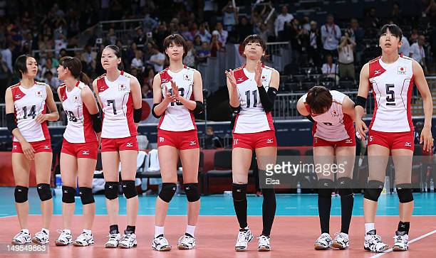 Japan players look on after losing the Women's Volleyball Preliminary match between Italy and Japan on Day 3 of the London 2012 Olympic Games at...
