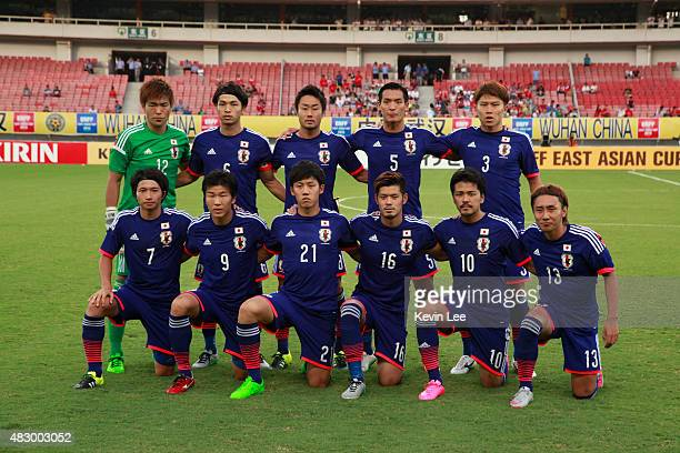 Japan players pose for a picture before the match against Korea during EAFF East Asian Cup 2015 final round in Wuhan Sports Center Stadium on August...