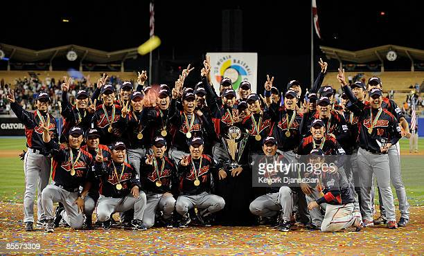 Japan players pose for photos after defeating Korea during the finals of the 2009 World Baseball Classic on March 23 2009 at Dodger Stadium in Los...