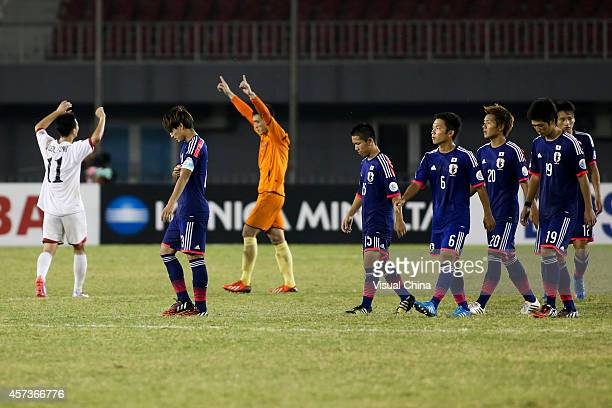 Japan players show their dejection after losing through a penalty shoot out after the AFC U19 Championship quarterfinal match between Japan and North...
