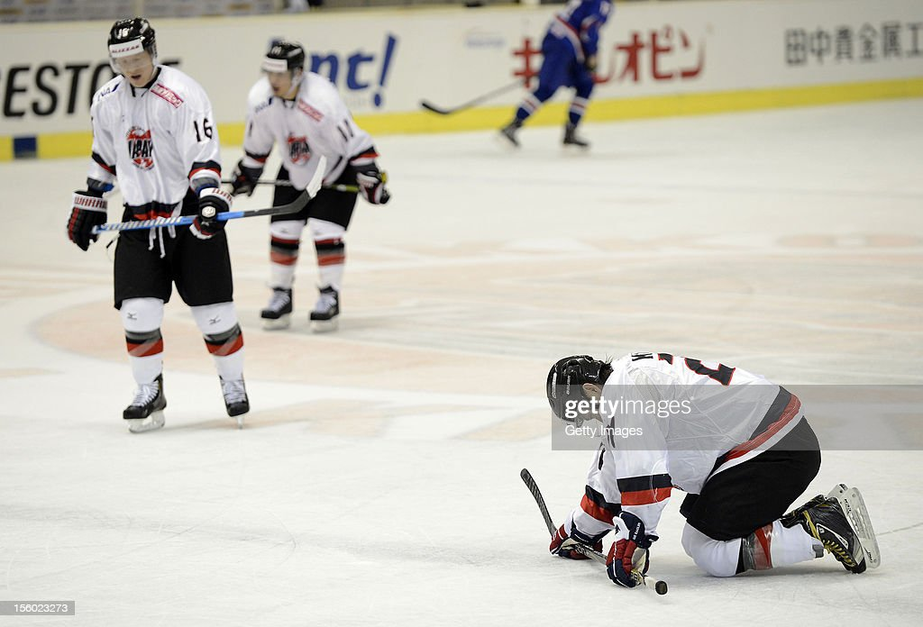 Japan players show their dejections after the Ice Hockey Sochi Olympic Pre-Qualification Group J match between Japan and Great Britain at Nikko Kirifuri Ice Arena on November 11, 2012 in Nikko, Tochigi, Japan. Great Britain won 2-1 and went through to the final qualification.