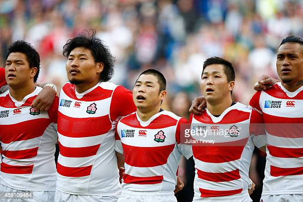 Japan players sing the national anthem ahead of the 2015 Rugby World Cup Pool B match between South Africa and Japan at the Brighton Community...