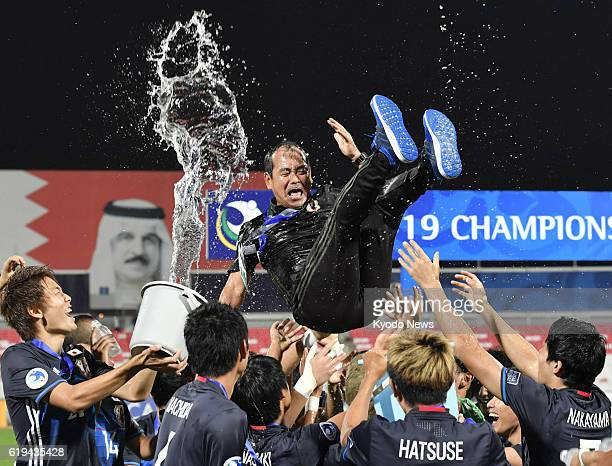 Japan players toss their coach Atsushi Uchiyama in the air after defeating Saudi Arabia 53 on penalties to claim the country's first Asian Under19...