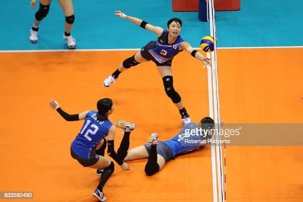 Japan players try to control the ball during the 19th Asian Senior Women's Volleyball Championship 2017 Final match between Thailand and Japan at...