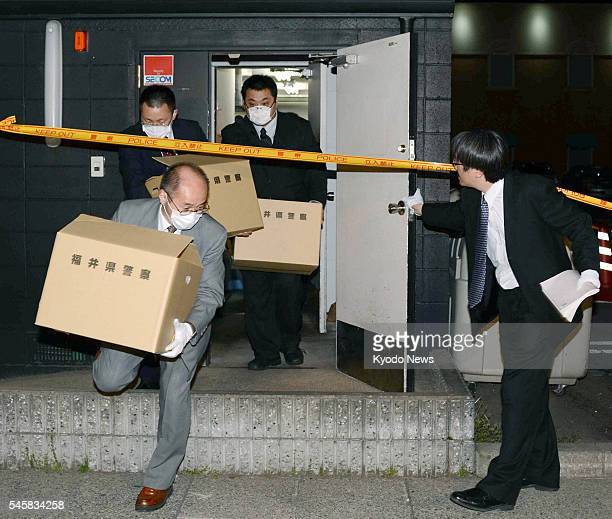 FUKUI Japan Police investigators bring out boxes of confiscated materials from an outlet of the Yakinikuzakaya Ebisu restaurant chain in Fukui on May...