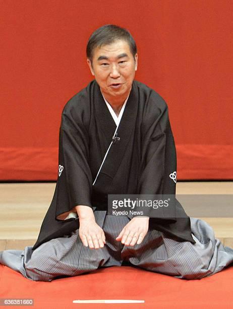 OSAKA Japan Popular 'rakugo' storyteller Katsura Bunshi greets the audience on March 8 in Osaka western Japan during the grand finale of a series of...