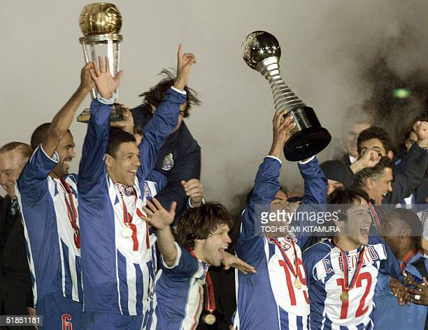 Portugese football club FC Porto midfielder Costinha holds the Intercontinental Cup and midfielder Carlos Alberto holds the Toyota Cup as other team...