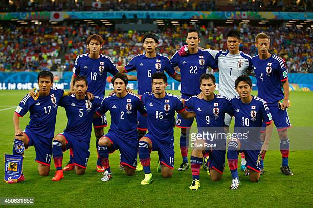 Japan pose for a team photo before the 2014 FIFA World Cup Brazil Group C match between the Ivory Coast and Japan at Arena Pernambuco on June 14 2014...
